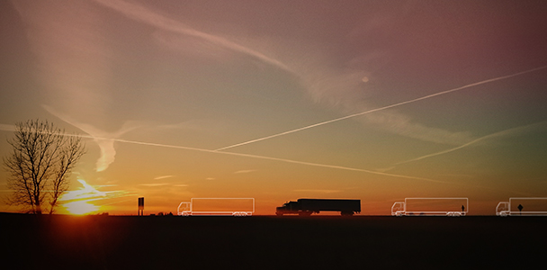 A truck and truck outlines and a sunset